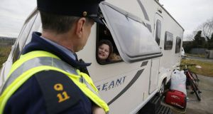 A garda speaks to a child at the halting site on the Balgaddy Road, Clondalkin in January. Photograph Nick Bradshaw
