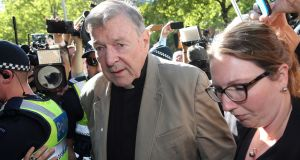 Cardinal George Pell makes his way on Wednesday to  Melbourne County Court, where he was remanded in custody pending sentencing for  sexually abusing two choir boys in Australia two decades ago. Photograph: Con Chronis/AFP/Getty Images
