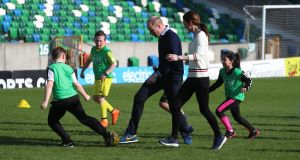 The Duke and Duchess of Cambridge take part in a coaching session during their visit to Windsor Park, Belfast as part of their two day visit to Northern Ireland. Photograph: PA