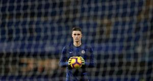Chelsea goalkeeper Kepa Arrizabalaga warms up at Stamford Bridge ahead of the  Premier League  match against  Tottenham Hotspur. The Spanish player has been dropped to the bench with Willy Caballero starting. Photograph:    Adrian Dennis/AFP/Getty Images