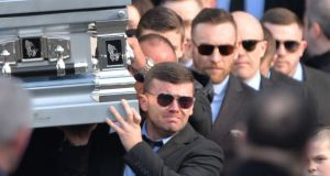 Liam Byrne (centre) carries his brother David's coffin at this funeral in Dublin in 2016. Photograph: Photograph: The Irish Times