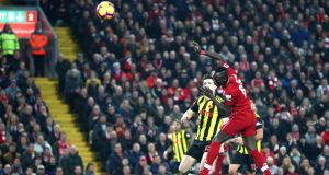 Sadio Mané scores Liverpool's first goal in the Premier League match against Watford at Anfield. Photograph: Clive Brunskill/Getty Images