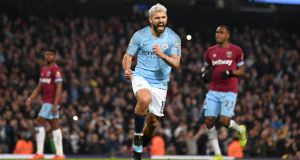 Sergio Agüero  celebrates after scoring a penalty for Manchester City  during the Premier League match against West Ham at the Etihad stadium. Photograph: Laurence Griffiths/Getty Images