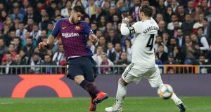 Barcelona's Luis Suarez scores in the  Copa del Rey  semi-final second leg against Real Madrid at the Santiago Bernabeu stadium in  Madrid. Photograph: Susana Vera/Reuters