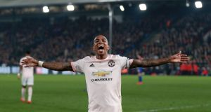 Ashley Young celebrates Manchester United's third against Crystal Palace. Photograph: Ian Walton/Reuters