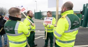 National Ambulance Service staff picket a depot on Davitt Road, Dublin. Photograph: Dara Mac Dónaill/The Irish Times