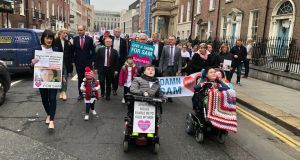 Opposition politicians joined families of children with spinal muscular atrophy who are seeking access to a new drug, Spinraza, in a march to Leinster House on Thursday. Photograph: Paul Cullen
