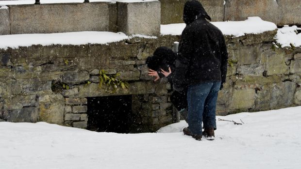 A homeless person living in a hole in a wall near a waterway in Dublin. Photograph: Alan Betson / The Irish Times
