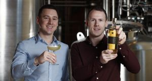 Éanna and Cian Burke, founders of  Gaslamp Distillery, with their Old Tom gin. Photograph: Conor McCabe