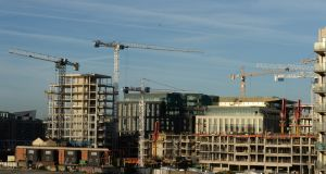 Cranes in the Dublin skyline in the docklands area: Organised local opposition to major infrastructural initiatives  retard economic growth and threaten Ireland's future. Photograph: Dara Mac Dónaill