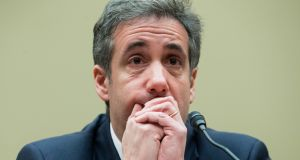 "Michael Cohen, former lawyer to President  Trump, before the House Oversight Committee   in Washington. He denounced the president  as a ""conman"", a ""cheat"" and a ""racist"".  Photograph: EPA/Michael Reynolds"