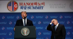 US president Donald Trump speaks as Secretary of State Mike Pompeo looks on during a news conference after a summit with North Korean leader Kim Jong Un in Hanoi on Thursday. Photograph: Evan Vucci/AP