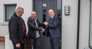 Fr Peter McVerry, Liam Coughlan and Pat Doyle, chief executive of the  Peter McVerry Trust. Mr Coughlan is the first resident of the new social housing programme in Coldwinters, north Co Dublin. Photograph: James Forde