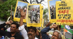 Indians  shout slogans against Pakistan as they hold posters and pictures of captive Indian Air Force pilot Abhinandan Varthaman. Photograph: Dibyangshu Sarkar/AFP/Getty Images