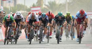 Italian Elia Viviani of DeceuninckQuick-Step team (second) sprints to win ahead of Colombian Fernando Gaviria of UAE Team during the fifth stage of the UAE tour in Khor Fakkan. Photograph:  Giuseppe Cacace/AFP/Getty Images