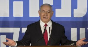 Israeli prime minister Binyamin Netanyahu:  a poll shows an indictment would result in Likud falling to 25 seats. The Blue and White alliance would rise to 44 seats.  Photograph: AP Photo/Sebastian Scheiner