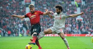 Manchester United's Luke Shaw in action against Liverpool's Mohamed Salah. Photograph: EPA