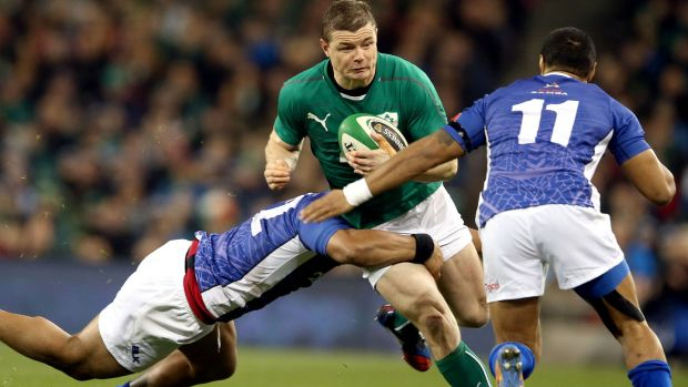 Brian O'Driscoll is tackled by Johnny Leota during Ireland's clash with Samoa in 2013. Photograph: Dan Sheridan/Inpho
