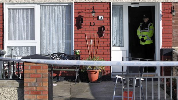 A garda at a house on Greenfort Drive, Clondalkin where the body of Cathy Ward was found. Photograph: Collins.