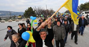 Crimean Tatar community with the Ukrainian flag in Bakhchisarai, south of Simferopol, on March 14th, 2014, two days before a referendum in Crimea to join Russia. Photograph: Viktor Drachev/AFP/Getty Images
