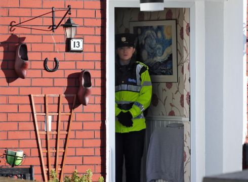 Garda at a house on Greenfort Drive, Clondalkin in Co Dublin, where the body of a woman in her 40s, Cathy Ward, was discovered after she was stabbed to death. Photograph: Colin Keegan/Collins Dublin