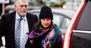 Huawei chief financial officer Meng Wanzhou arriving at a parole office with a security guard in Vancouver, Canada on December 12th. Photograph: Darryl Dyck/The Canadian Press via AP