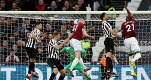 Declan Rice heads home to score West Ham's first goal in the Premier League game against Newcastle United  at London stadium. Photograph:  Paul Harding/PA Wire