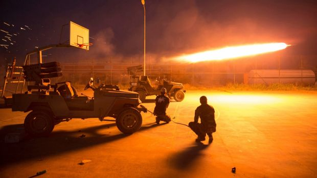 Rocketfire during clashes with Islamic State militants. Photograph: Reuters