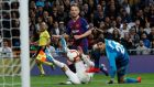 Barcelona's Ivan Rakitic scores their first goal during the  La Liga games against  Real Madrid at the  Santiago Bernabeu stadium in Madrid. Photograph: Juan Medina/Reuters
