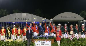 The Irish team of Lorcan Gallagher, Daniel Coyle, Michael Blake (team manager) Paul O'Shea and Shane Sweetnam stand on the podium along with Canada and USA following the Wellington Nations' Cup in Florida. Photograph: Sportfot