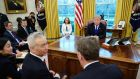 US president Donald Trump watches as China's vice premier Liu He speaks with US trade representative Robert Lighthizer in the Oval Office in February. Photograph:   Getty Images