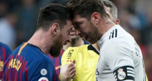 Barcelona's Lionel Messi argues with Real Madrid's Sergio Ramos during the El Clásico match between the sides on Saturday night. Photo: Curto de la Torre/Getty Images