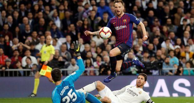 075e77e43 Ivan Rakitic of Barcelona beats Real Madrid s goalkeeper Thibaut Courtois.  Photograph  Juan Carlos Hidalgo