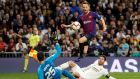 Ivan Rakitic of Barcelona beats Real Madrid's goalkeeper Thibaut Courtois. Photograph: Juan Carlos Hidalgo/EPA