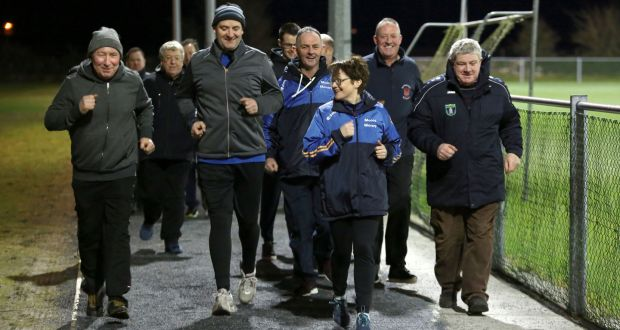 Laura Tully leads a group of participants in a Fit Farmers programme session at Pádraig Pearse's GAA club in Clooneen, Co Roscommon. Photograph: Joe O'Shaughnessy