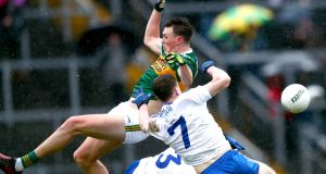 Kerry's Gavin O'Brien is challenged by Monaghan's Karl O'Connell and Drew Wylie. Photograph: James Crombie/Inpho