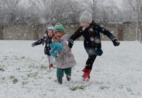 Clara Murphy, Bridget Harrington and Ella Murphy enjoy the snow at Dunboyne, Co Meath. Photograph: Alan Betson/The Irish Times
