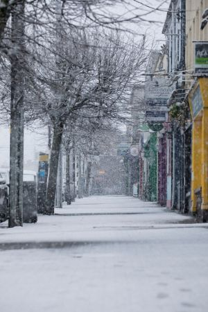 The empty streets of Newbridge as the snow falls around Co Kildare. Photograph: Michael Donnelly