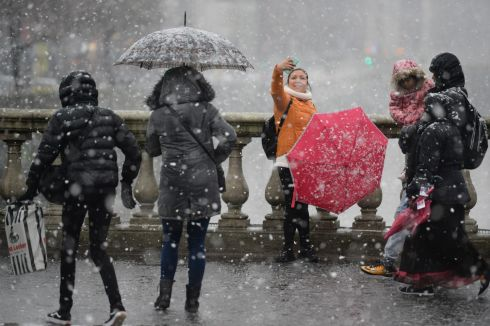 Snow falling in Dublin city centre on Sunday. A status yellow warning was issued for Leinster, Munster and parts of Ulster and Connacht. Photograph: Dara Mac Donaill/The Irish Times