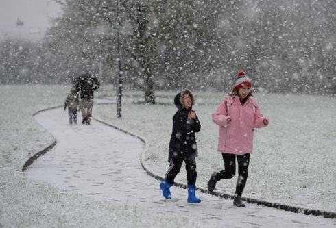 Alex and Hannah Betson enjoy the snow falling at Dunboyne, Co Meath. Photograph: Alan Betson/The Irish Times