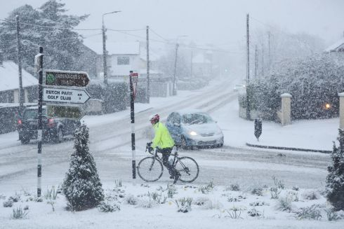 A cyclist braves the elements for a Sunday spin in Rathcoole, Co Dublin. Photograph: Niall Carson/PA Wire