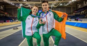 Ireland's Ciara Mageean and Mark English with their bronze medals at the European Indoor Athletics Championships. Photo: Morgan Treacy/Inpho