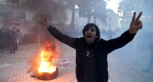 A supporter of the opposition party at an anti-government protest in front of the parliament in Tirana, Albania. Photograph: Florion Goga/Reuters