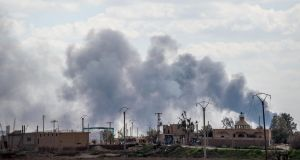 Smoke billows after shelling on Baghouz, Syria. Photograph: Bulent Kilic/AFP/Getty Images