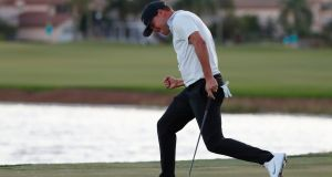 Keith Mitchell celebrates as he sinks his putt on the 18th hole to win the Honda Classic in Palm Beach Gardens. Photograph: AP