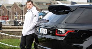 Jamie Heaslip with his Range Rover Sport PHEV (Plug-In Hybrid Electric Vehicle).