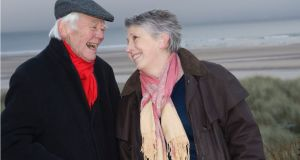 Steph Booth with her late husband, Tony on Alnmouth beach. Photograph: George Skipper