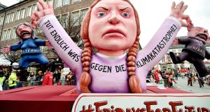 A float depicting Swedish climate activist Greta Thunberg during the annual Rose Monday parade in Duesseldorf, Germany, on Monday. Photograph: Kirsten Neumann/EPA