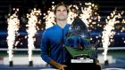 Roger Federer poses with his trophy after defeating Stefanos Tsitsipas of Greece in their final match in Dubai to claim his 100th title win. Photograph:   Ali Haider/EPA