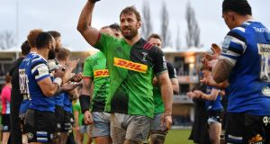 Chris Robshaw  of Harlequins celebrates as he leads the team off the field following their victory over Bath. Photograph:  Dan Mullan/Getty Images